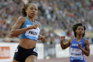 Allyson Felix from the USA, left, and Dezerea Bryant from the USA, right, compete in the women's 200m race at the Athletissima IAAF Diamond League athletics meeting in the Stade Olympique de la Pontaise in Lausanne, Switzerland, Thursday, July 9, 2015. (Jean-Christophe Bott/Keystone via AP)